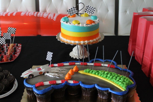 We had a pull apart cupcakes cake that we decorated as a racing car in motion and a small cake to hold the number 2 sparkle that was later light up for the birthday boy.